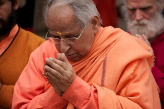 Swami Veda in 'Namaste' pose